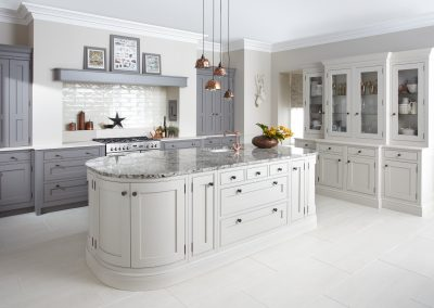 Painted Inframe Mink & Putty Kitchen With Black Copper Effect Knob Handles.