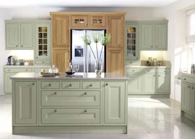 Painted Inframe Willow Mint Kitchen With Light Oak Feature Cabinetry.