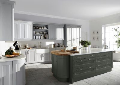 Painted Seal And Light Grey Shaker Kitchen With Curved Finishes.