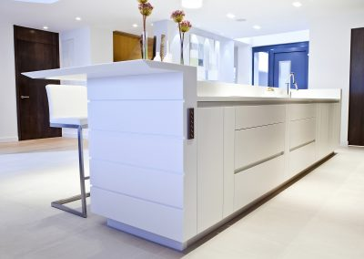 The Ice White Corian Island Lower level View Of Drawer System, Finishing And Extraction Control.