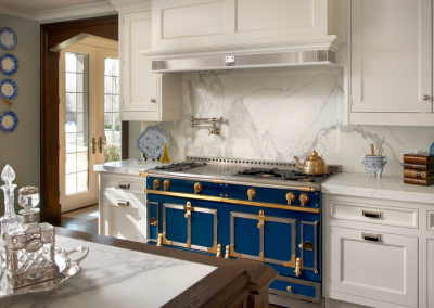 La Cornue Blue Oven With White Kitchen Cabinetry.