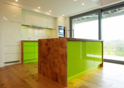 Resin Drawer Kitchen In Lime, With Organic Cats Paw Timber Worktop, Panelling & Cream Accent Storage.