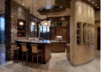 Central kitchen With Feature Stone Wall & Curved Partition With Shelving.