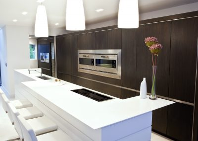 The Deep Tones Of The Walnut Cabinetry Provides Contrast To The Island & Defines The Kitchen Area In The Room.