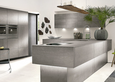 CAD Of Modern Concrete Kitchen With Over Hanging Peninsula.
