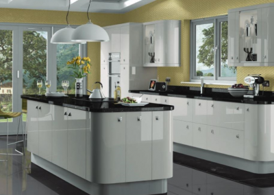 Gloss Island kitchen With Subtle Curves In White, Cream Or Kashmir.