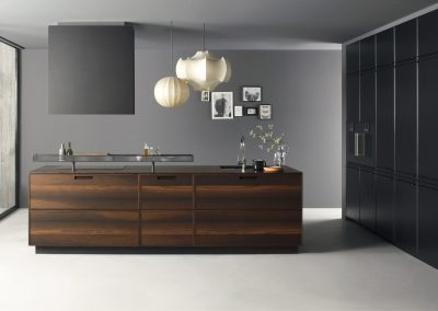 Kitchen In Accented Matt Walnut Timber Drawer Island, Aluminium Shelf and Black Side Storage.