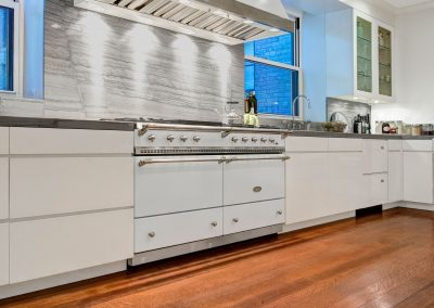 White Lacanche Range Integrated With Modern Ice White Kitchen.