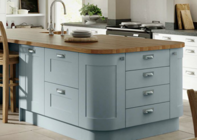 Matt Fiord Painted Or Vinyl Wrapped Kitchen With Curved Island Kitchen & White Feature Storage.