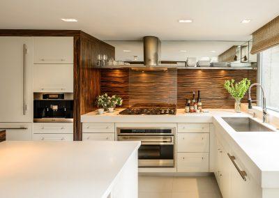 Kitchen In Gloss or Matt White With Macassar Ebony Decor & Corian Worktops.