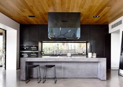Concrete Island & Basalt Kitchen Storage.