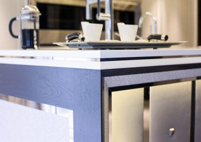 Feature Kitchen Panelling, Textured & Steel Trims.