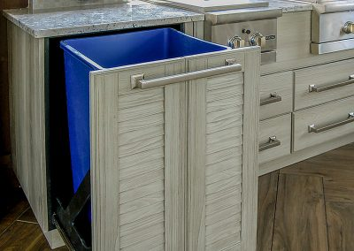 Close Up Of Pull Out Kitchen Storage In Silver Birch Finish.