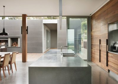 Concrete Featured Kitchen With Timber Cabinetry.
