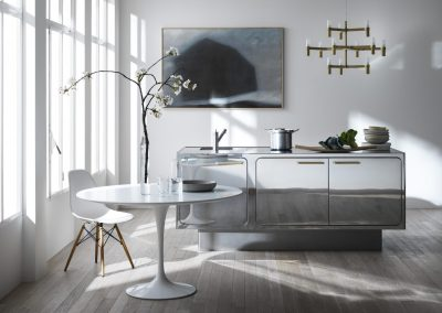 This Nu Curve Credenza Kitchen Island with bespoke mirrored finish was created to give a minimalist feel to the room.