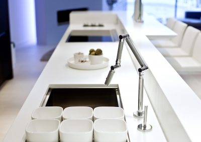Bespoke Sink & Taps Were Designed Into The Corian Island Worktop To Create A Self Sustained Kitchen Preparation Area.
