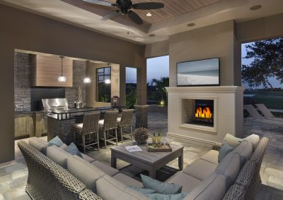 Feature Log Fireplace In Interior Living Space & Kitchen Design.