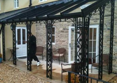 Wrought Iron Canopy Design With Optional Solar Integration.