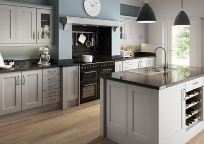Putty Grey Or Cashmere Shaker Kitchen With Featured Island In White.