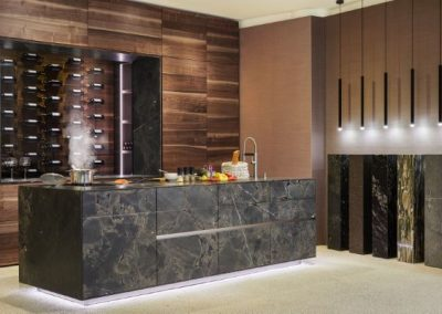 Credenza Moss Stone Kitchen With Wine Storage & Cabinets & Featured Stone Column Design.