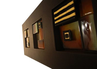 Glass Art In Leather Frame Finish.