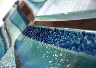 Glass Wave Art In Sky & Tan Close Up Image.