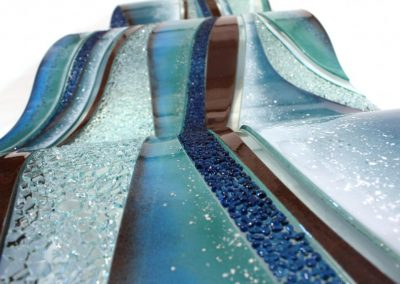 Glass Wave Art In Sky & Tan Curve Profile.
