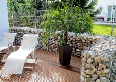 Large Pebble Walled Patio.