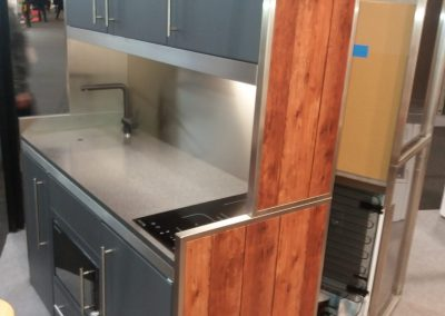 Latest Steel Framed Charcoal Grey Kitchen With Wood Cladded Finish.