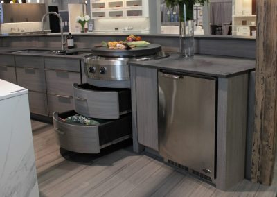 Curved Ceramic Grill Cabinet With Drawers Open.