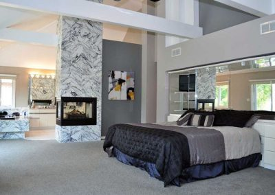 Modern Master Bedroom, Fireplace and Marble Finish.