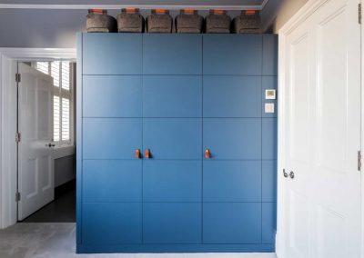 Multi Bedroom Cupboard Storage In Blue.