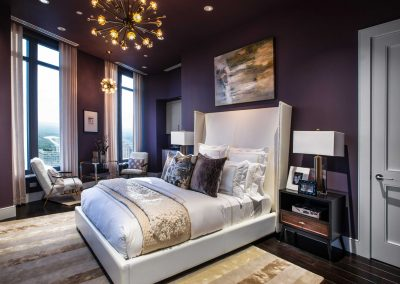 Plum Decor Bedroom With Creams & Collar Headboard.