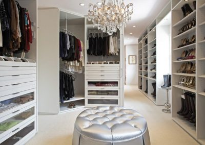 Luxury Design Closets With Crystal Chandelier & White Round Sofa.