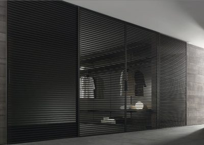 Strip Black Closet With Glazing & Grey Textured Panelling.