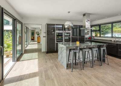 Glazed Extension Development With Charcoal & Granite Kitchen.