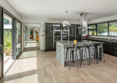 Glazed Extension Development With Charcoal & Granite Kitchen.