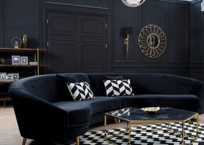 Cresent Sofa Design In Black or Blue With Brass legs.